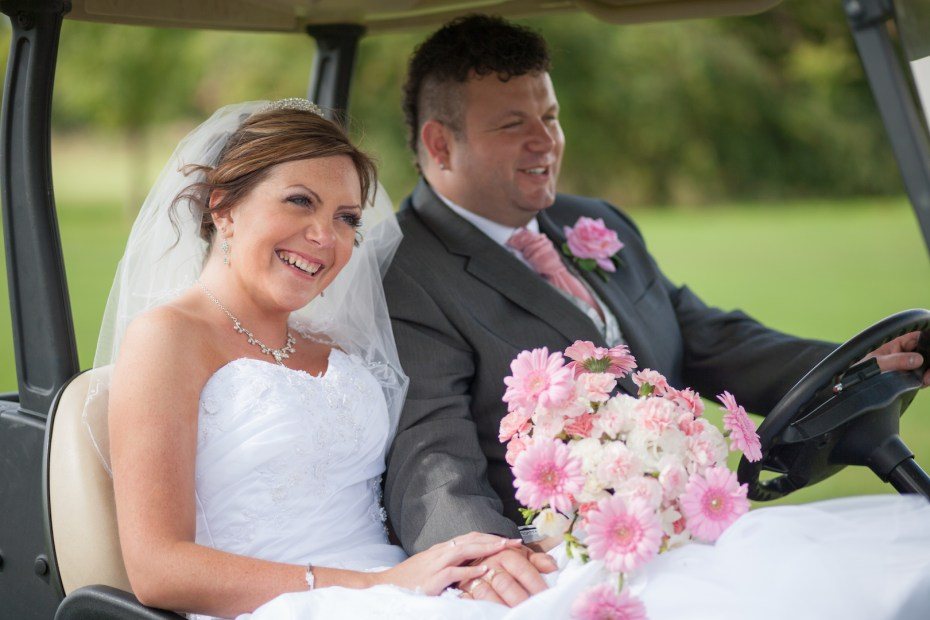 Wedding ride in a golf buggy