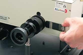 A fixed width slit being installed into an Oriel Cornerstone 130 monochromator.
