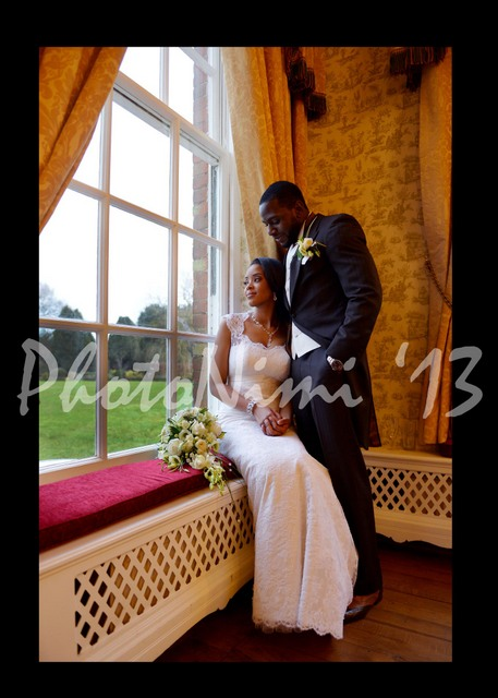 the odukoyas, couple by the window, photo nimi