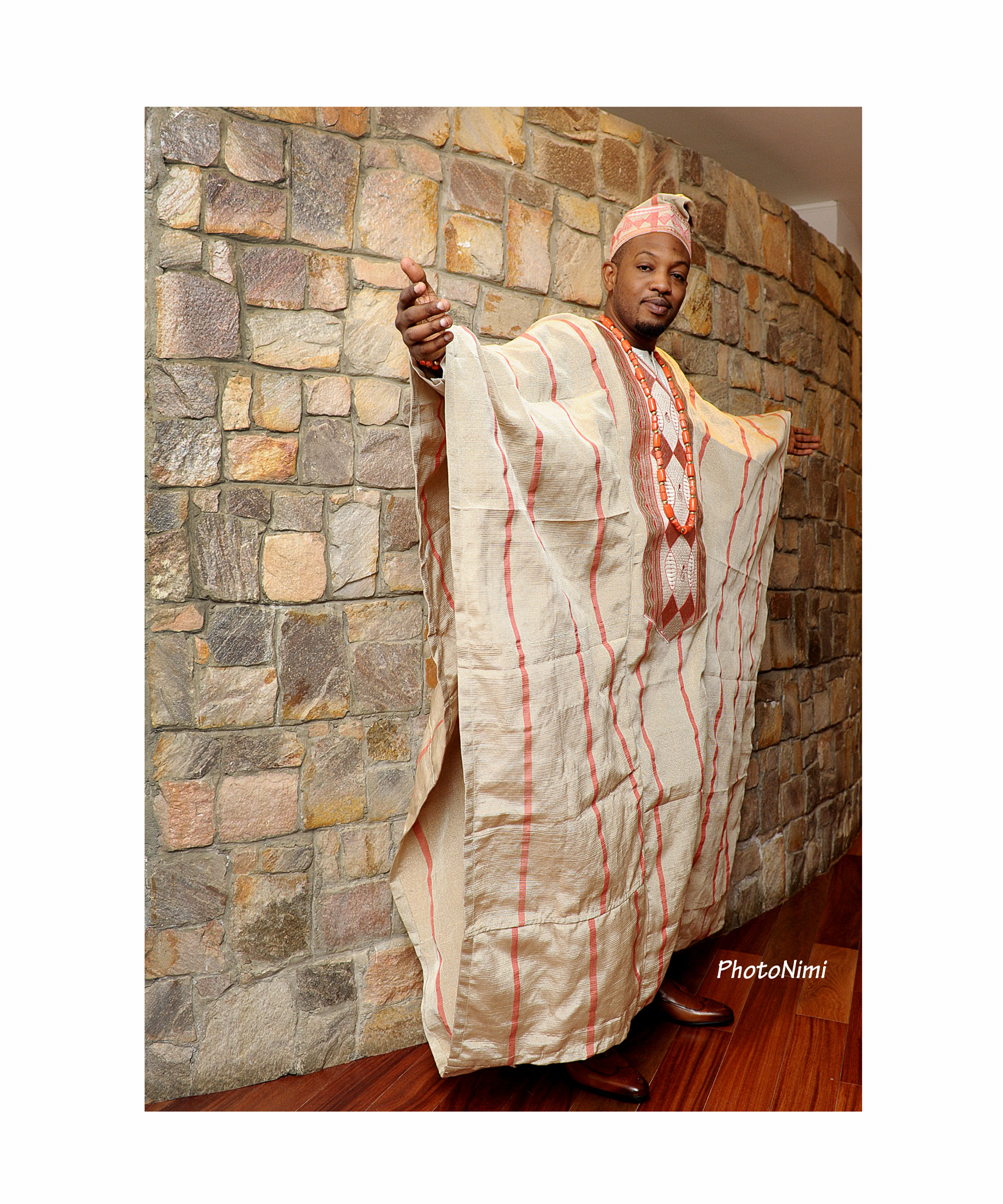 niyi, groom in traditional aso-ofi agbada, traditional wedding