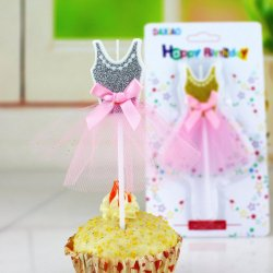 A cupcake or cake ballerina candle shaped as the dress with tutu