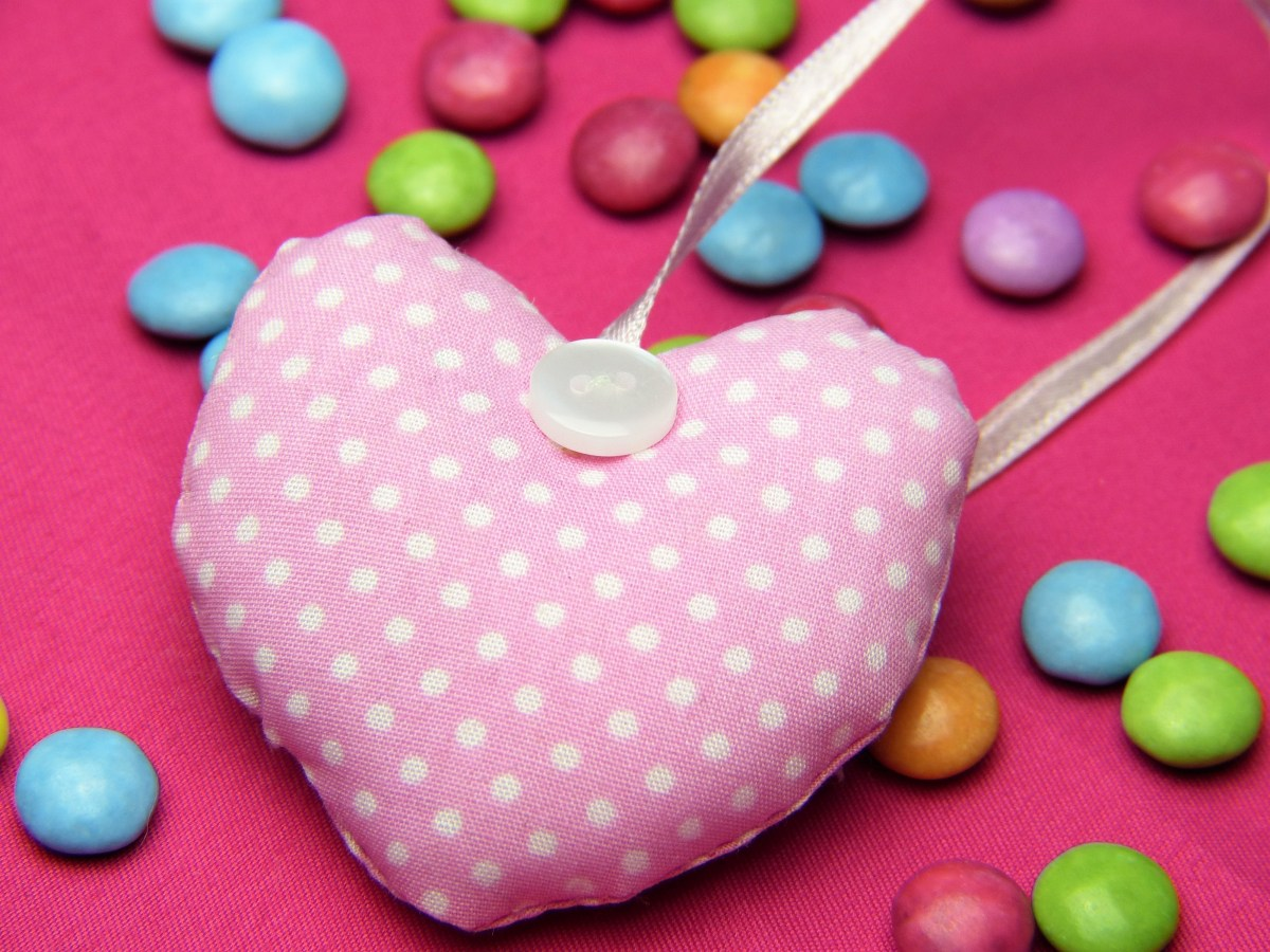 Pink heart and multicolored candy