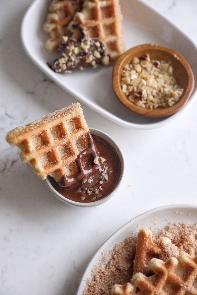 waffle quarter sitting in a small bowl of dark chocolate