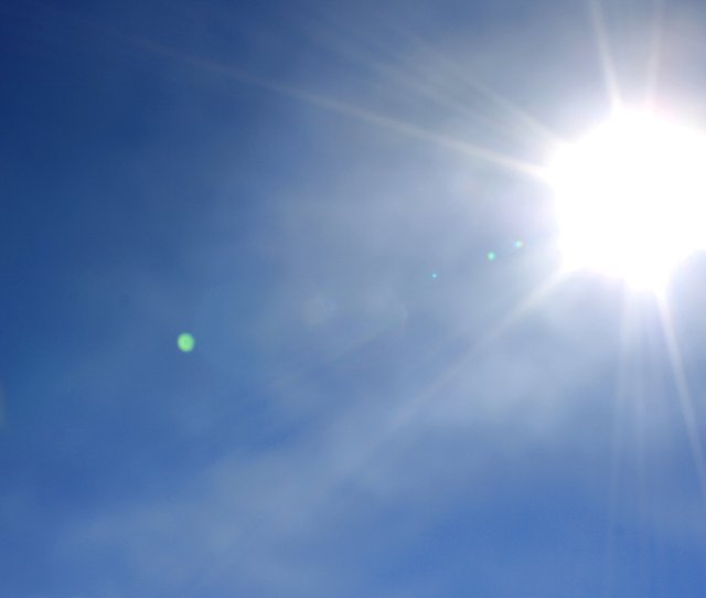 Bright Sun In Clear Blue Sky