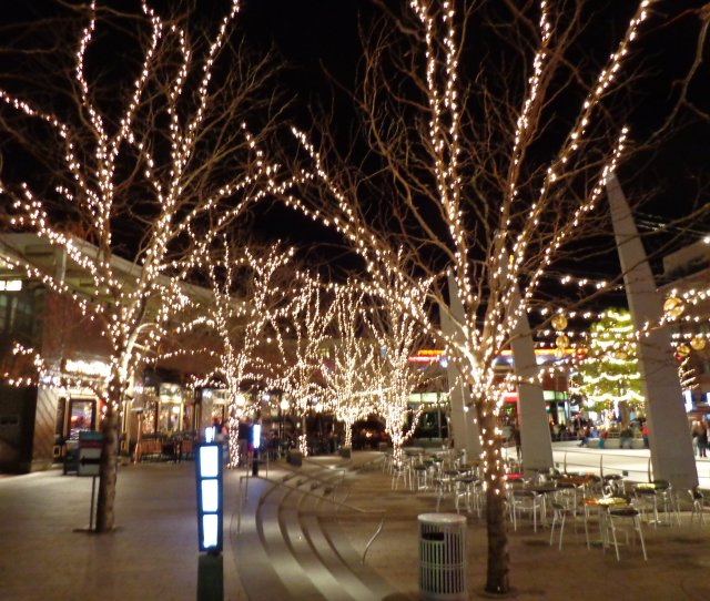 Outdoor Plaza Nighttime Scene With Skating Rink And Christmas Lights