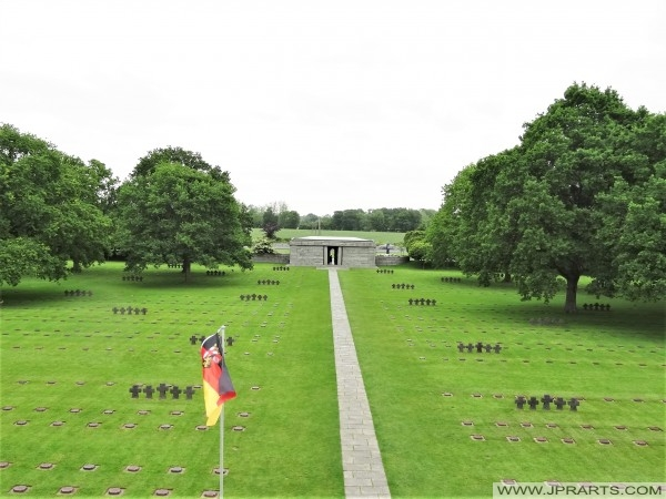 Section of the cemetery viewed from the Tumulus. The graves of SS officer Michael Wittmann and his Tiger 007 crew lie just beyond the trees on the left (Normandy, France)