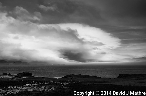 Storm Clouds and Fog Bank Along the East Coast of Iceland. Image taken with a Leica X2 camera (ISO 100, 24 mm, f/5, 1/500 sec). Raw image converted to B&W with Nik Silver Efex Pro. (David J Mathre)