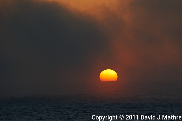 Pacific Sunset in Fog off the Mexican Coast. Image taken with a Nikon D3s and 70-300 mm VR lens (ISO 200, 300 mm, f/5.6, 1/400 sec). (David J Mathre)