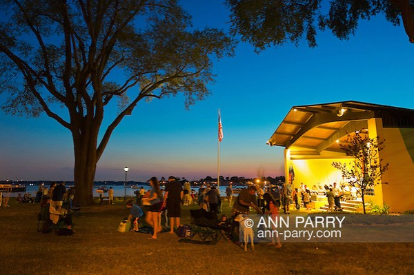 Port Washington, New York, U.S. - July 11, 2014 - Audience gets ready to leave at end of night time outdoors band concert at John Philips Sousa Memorial Band Shell, at Sunset Park on Manhasset Bay in the North Shore village on Long Island Gold Coast. (Ann Parry/Ann Parry, ann-parry.com)
