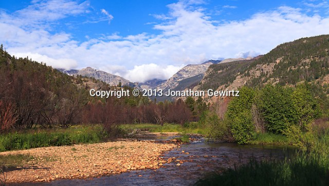 Majestic mountains overlook a tranquil meadow and stream in Rocky Mountain National Park near Estes Park, Colorado. (© 2013 Jonathan Gewirtz / jonathan@gewirtz.net)