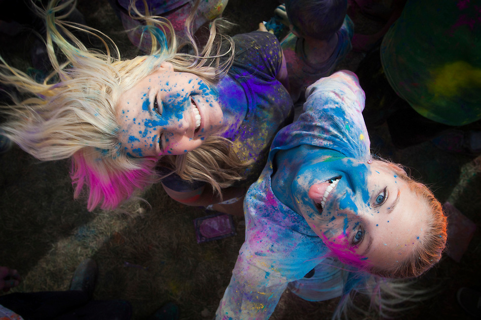 Crowds jump up and down to music in front of the stage during the Holi Festival of Colors, on Saturday, Mar. 24, 2012, at the Lotus Temple, in Spanish Fork, Utah. (Photo by Benjamin B. Morris ©2012) (Benjamin B. Morris)