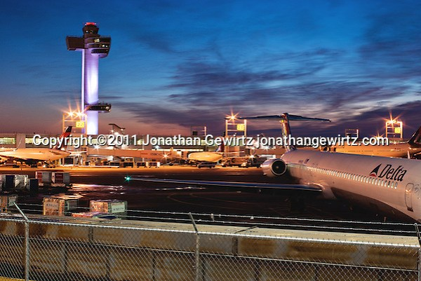 Delta Airlines aircraft parked near the control tower at New York's John F. Kennedy International Airport at dawn. (Jonathan Gewirtz)