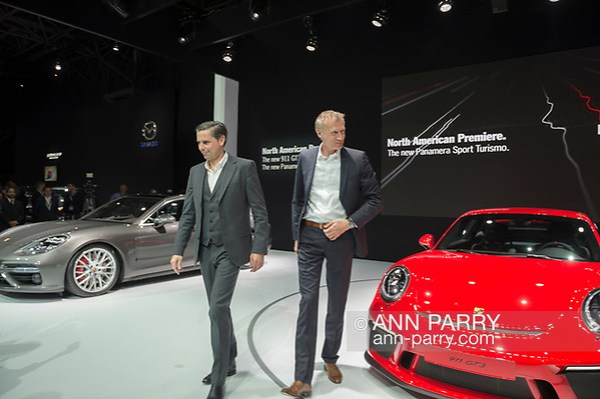 Manhattan, New York, USA. April 12, 2017. L-R, KLAUS ZELLMER, President and Chief Executive Officer of Porsche Cars North America, Inc, and ANDREAS PREUNINGER, GT Project Director Porsche AG, introduce two new cars making their North American Premiere: Panamera Sport Turismo (silver car on left) and 911 GT3 (red car on right) during the Porsche Press Conference at the New York International Auto Show, NYIAS, during the first Press Day at the Javits Center. (Ann Parry/Ann Parry, ann-parry.com)