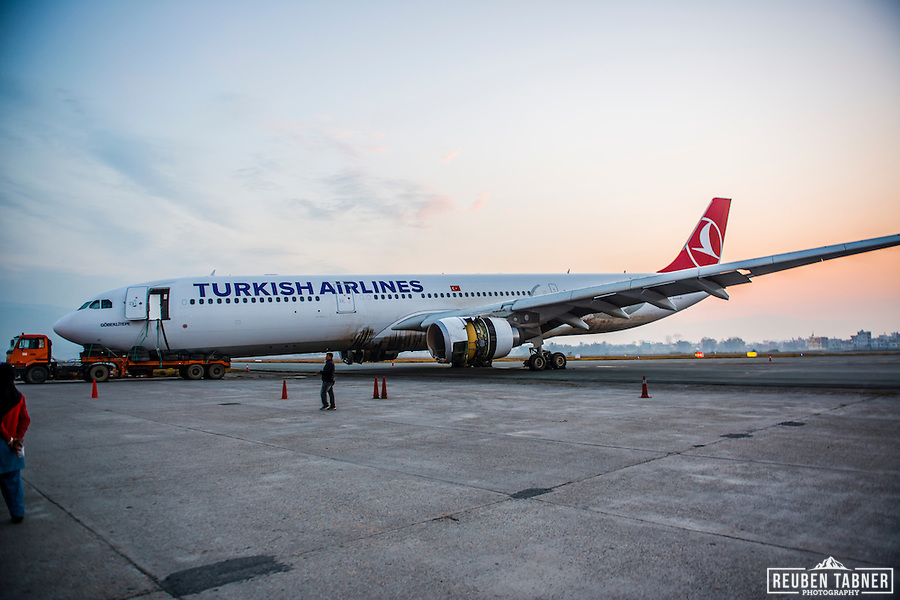 The nose of the crashed Turkish Airlines Airbus 330 (flight TK726) plane rests on a flatbed tow truck several days after it slid off the tarmac at Kathmandu's Tribhuvan International Airport (TIA). (Reuben Tabner/© Reuben Tabner)