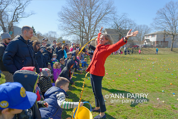 North Merrick, New York, USA. March 31, 2018. Nassau County Executive LAURA CURRAN flings her arms up high after cutting the yellow tape to start the Egg Hunt at the Annual Eggstravaganza, held at Fraser Park and hosted by North and Central Merrick Civic Association (NCMCA) and Merrick's American Legion Auxiliary Unit 1282. (© 2018 Ann Parry/Ann-Parry.com)