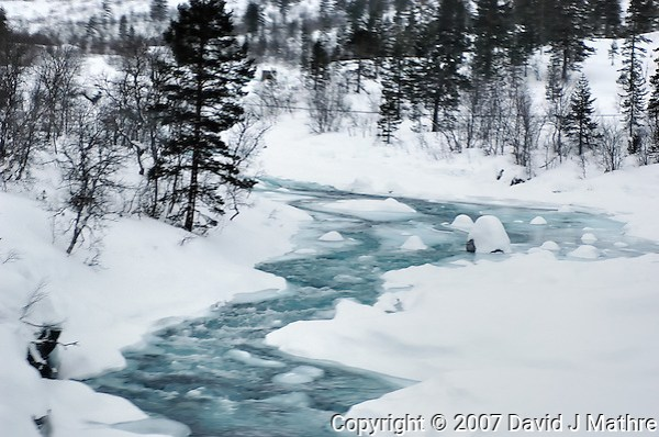 Winter Stream in Norway. Image taken with a Nikon D2xs and 28-70 mm f/2.8 lens (ISO 100, 70 mm, f/3.5, 1/50 sec) (David J. Mathre)