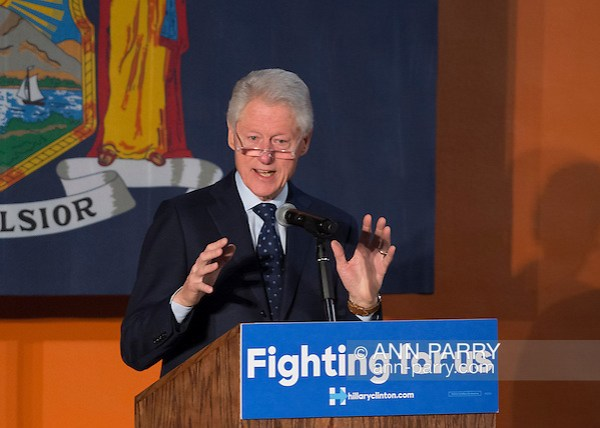 Elmont, New York, USA. April 5, 2016. Former President Bill Clinton, wearing reading glasses, is the headline speaker as he campaigns at an Organizing Event rally in Elmont, Long Island, on behalf of his wife, Hillary Clinton, the leading Democratic presidential candidate, and former Secretary of State and U.S. Senator for New York. The New York Democratic Primary takes place April 19th. (Ann Parry/Ann Parry, ann-parry.com)