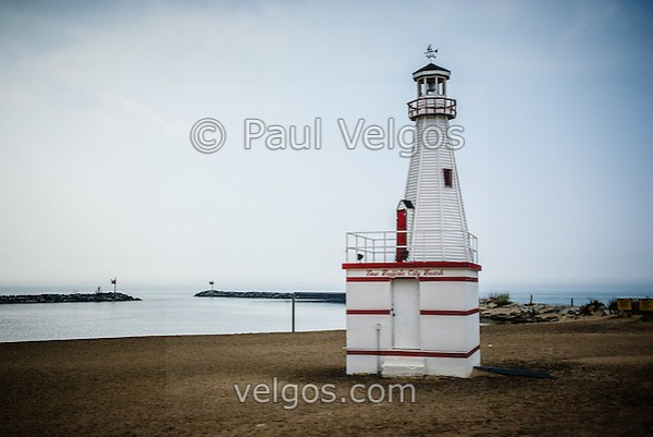 Photo of the New Buffalo city beach lighthouse in New Buffalo Michigan with Lake Michigan. (Paul Velgos)