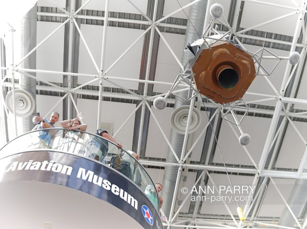 Garden City, NY, U.S. July 20, 2019. Visitors look down from high landing on the 3rd floor staircase near the 1/3 scale model of Apollo 11 Lunar Module The Eagle suspended from ceiling and ready to descend at exact time Apollo 11 Lunar Module landed on the Moon 50 years ago, at Apollo at 50 Countdown Celebration at Cradle of Aviation Museum. (© 2019 Ann Parry/Ann-Parry.com)