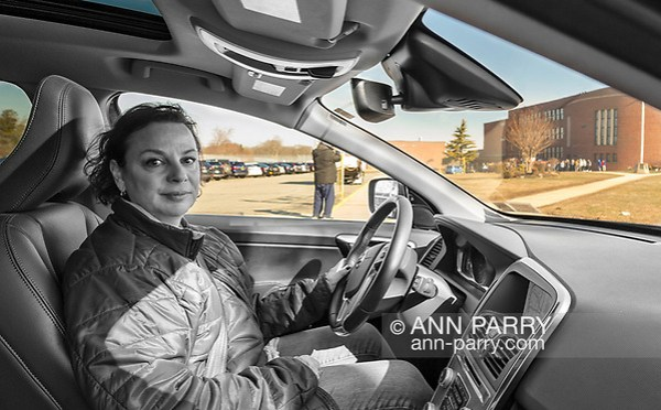 North Bellmore; New York; USA. March 14; 2018. CRYSTAL PHOTIOU, of Bellmore, drove to Mepham to watch students walkout to protest gun violence.