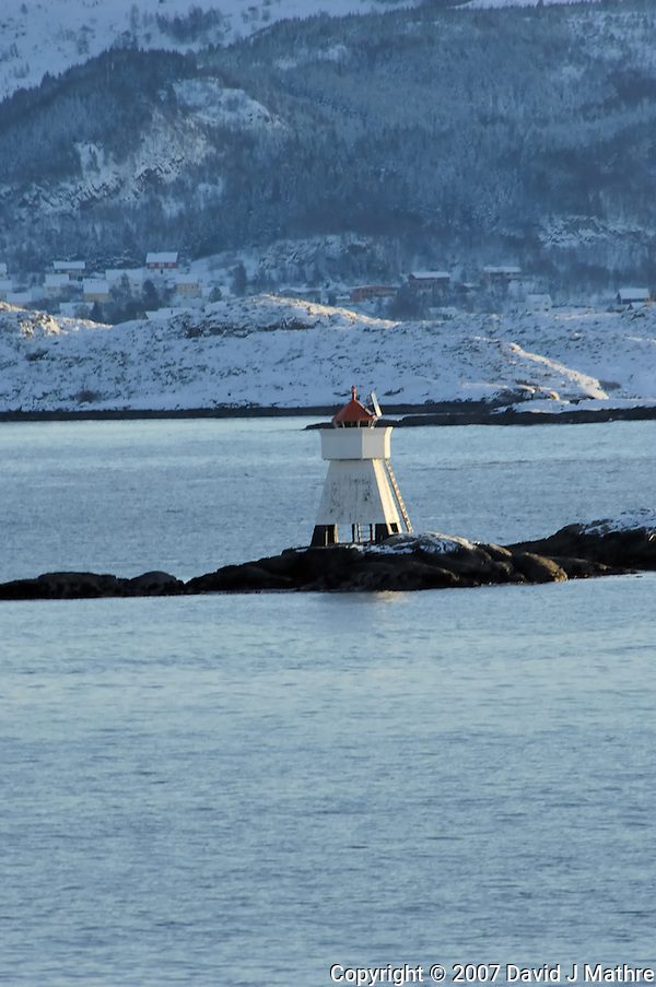 Lighthouse while leaving Torvik. Image taken with a Nikon D2xs and 80-400 mm VR lens (ISO 200, 400 mm, f/8.5, 1/250 sec). (David J. Mathre)
