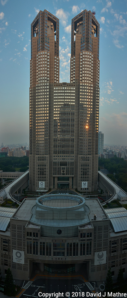 Reflections of the Sun Rising. Tokyo Metropolitan Government Building from the Keio Plaza Hotel. Composite of six images taken with a Leica CL camera and 23 mm f/2 lens. Raw images processed with Capture One Pro and AutoPano Giga Pro. (David J Mathre)