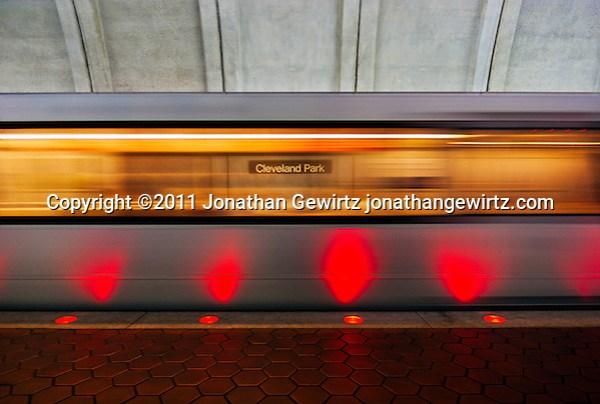 A Washington, DC Metro system subway train moves through the Cleveland Park station. (© Jonathan Gewirtz, jonathan@gewirtz.net)