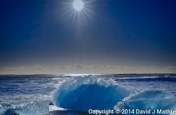 Sunburst and Glacial Ice on the Beach near Jökulsárlón in Southeastern Iceland. HDR composite taken with a Fuji X-T1 camera and Zeiss 32 mm lens (ISO 200, 32 mm, f/16) (David J Mathre)