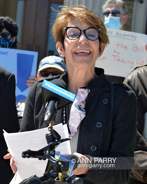 """Mineola, NY, USA. April 26, 2021. MARGARET MAHER, from non-profit Food and Water Watch, speaks at rally. Faced with a 26% rate increase from New York American Water going into effect May 1, 2021, activists and residents who are NYAW customers rally to urge NYS Assembly to push through legislation, before that date, corresponding with NYS Senate Bill S989A to establish a Nassau County Water Authority. (© 2021Ann Parry/AnnParry.com)"