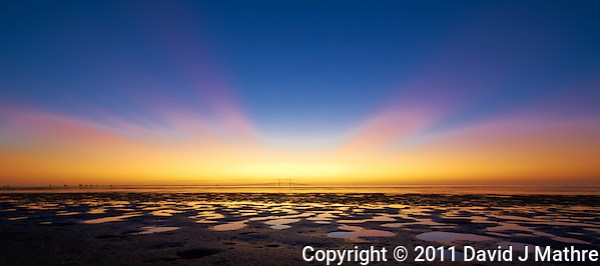 Low Tide Panorama of the Sunshine Skyway Bridge at Dawn. Taken from Fort Desoto County Park in St. Petersburg, Florida. Image taken with a Nikon D3s and 14-24 mm f/2.8 lens (ISO 200, 14 mm, f/16, 1 sec). (David J. Mathre)