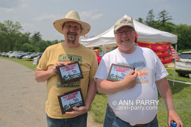 Old Westbury, New York, USA. June 2, 2019. L-R, SCOTT GRAMLICH, of Baldwin, holds 2 award plaques his 1925 Model T Ford won, and KEITH GRAMLICH, holds the award plaque his 1928 Studebaker Dictator, Club Sedan won at the 53rd Annual Spring Meet Antique Car Show, sponsored by the Greater NY Region (NYGR) of the Antique Automobile Club of America, at Old Westbury Gardens. (© 2019 Ann Parry/Ann-Parry.com)