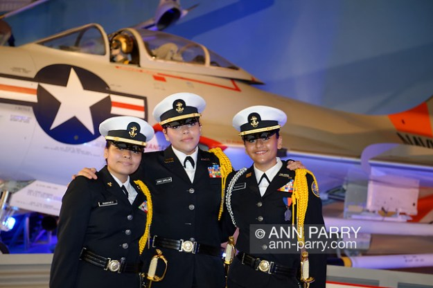 Garden City, New York, U.S. June 6, 2019. Three Freeport High School Navy Junior ROTC cadets wearing uniforms and about to participate at Apollo at 50 Anniversary Dinner at Cradle of Aviation Museum, pose for photo in front of historic aircraft at museum exhibit. (© 2019 Ann Parry/Ann-Parry.com)
