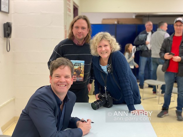 Merrick, New York, U.S. Dec. 20, 2019. L-R, Kevin Shinick, Chris Barron, and Ann Parry strike a pose at book signing for author Shinick's STAR WARS: FORCE COLLECTOR at North Merrick Library on Nassau County Force Collector Day. (© 2019 need photographer's name)