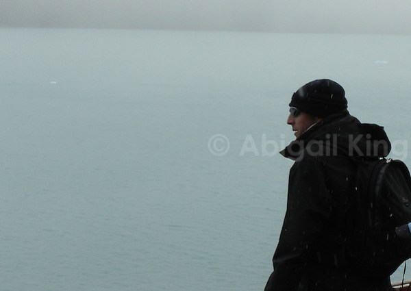 Man overlooking snow and ice in Patagonia