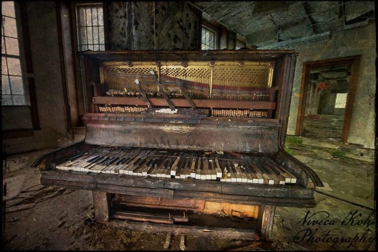 Piano in an abandoned mental asylum (Viveca Koh)