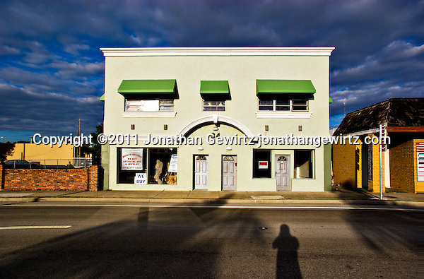 Morning sun illuminates a building on Dixie Highway, Dania, Florida. (Jonathan Gewirtz)