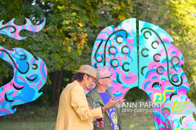 Roslyn, New York, U.S. September 13, 2019. L-R, GARY BARAT and Dr. HARVEY MANES discuss large outdoor dragon Animodules at ANIMODULES Agents of Peace exhibit Farewell Reception and Founders' talk by Gary Barat and Chandri Barat at the Nassau County Museum of Art's Manes Art & Education Center, named for Dr. Manes, who spearheaded the exhibit. (Ann Parry/Ann Parry, ann-parry.com)