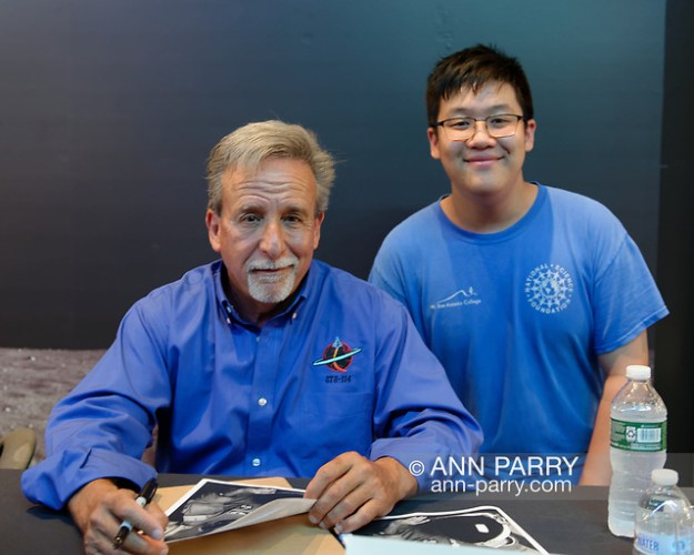Garden City, NY, U.S. July 20, 2019. L-R, NASA Space Shuttle astronaut CHARLIE CAMARDA poses with DASHIELL CHEN, 13, at the Moon Fest Apollo at 50 Countdown Celebration at Cradle of Aviation Museum in Long Island. Camarda was in a summer program, for middle school STEM students, at Mount San Antonio Community College in California. © 2019 (Ann Parry/Ann-Parry.com)