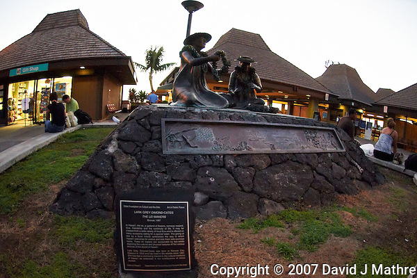 "Kona International Airport Waiting Area. Bronze of ""The Lei Makers"" Image taken with a Nikon D300 and 10.5 mm f/2.8 fisheye lens (ISO 1400, f/2.8, 1/125 sec). With Nik Define 2 noise reduction applied. (David J Mathre)"