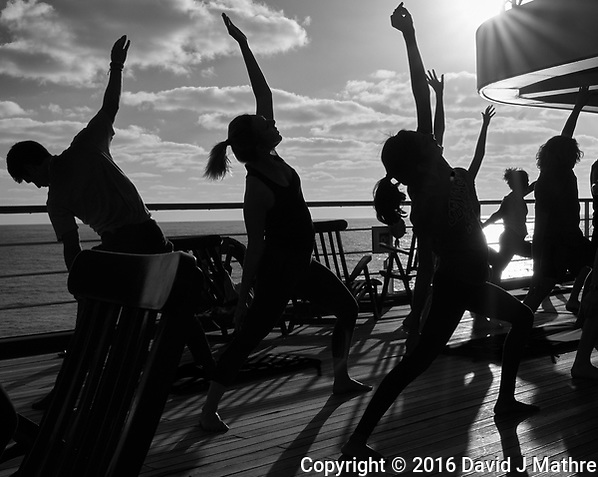 Afternoon yoga in the sun on the aft deck of the MV World Odyssey Image taken with a Leica T camera and 11-23 mm lens (ISO 100, 23 mm, f/14, 1/500 sec). Raw image processed with Capture One Pro including conversion to B&W. (David J Mathre)