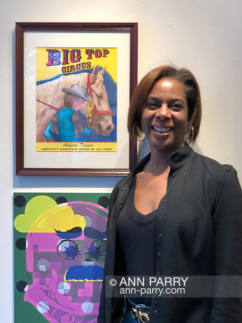 "Huntington, NY, USA. March 29, 2019. Angela Tigner poses next to Robert Stuhmer's illustration ""Bareback Rider"" at the Huntington Arts Council Reception for Lowbrow Art Exhibition. Tigner was the model for the Big Top Circus bareback rider."