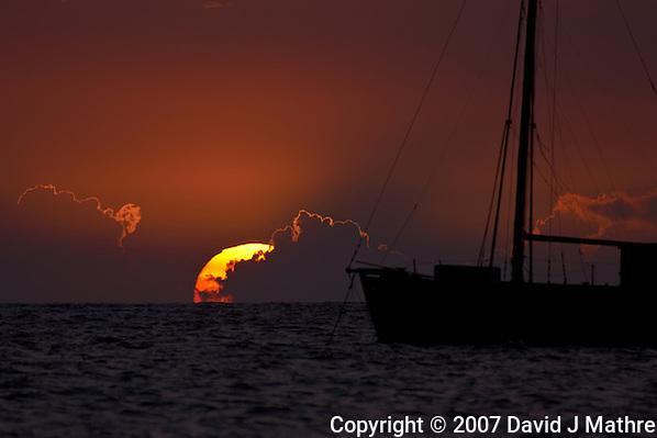 Sunset and Sailboat off Kona Beach, Big Island Hawaii. Day 1 of Thom Hogan's 2007 Hawaii Photography Workshop. Image taken with Nikon D2xs and 80-400 mm VR lens (ISO 100, 400 mm, f/5.6, 1/500 sec). (David J Mathre)
