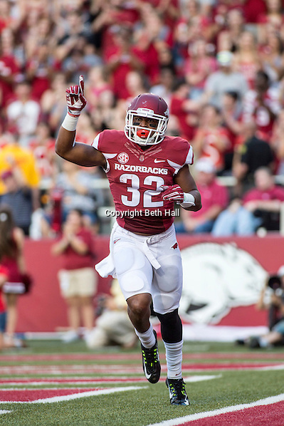 Sep 20, 2014; Fayetteville, AR, USA; Arkansas Razorbacks running back Jonathan Williams (32) reacts to a scoring a touchdown during the first half of a game against the Northern Illinois University Huskies at Donald W. Reynolds Razorback Stadium. Arkansas defeated NIU 52-14. Mandatory Credit: Beth Hall-USA TODAY Sports (Beth Hall/Beth Hall-USA TODAY Sports)