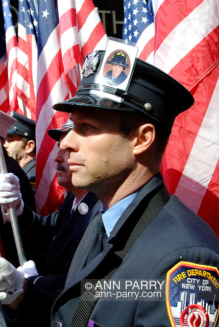 Manhattan, NY, USA. March 17, 2009. FDNY firefighter LUKE ALLEN wears in his hat a card with photo of his older brother firefighter RICHARD D. ALLEN, one of 343 FDNY firefighters killed responding to terrorist attacks on Twin Towers 9/11. (© 2009 Ann Parry/Ann-Parry.com)