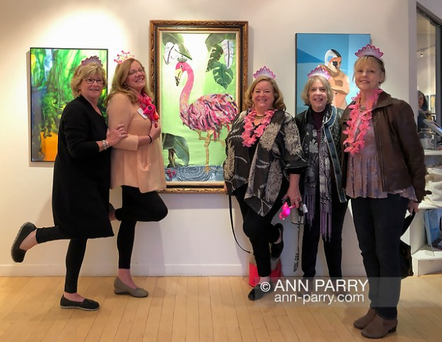 Huntington, NY, USA. March 29, 2019. At left of her More-a-Logo artwork, Eileen Palmer does a Pink Flamingo pose with some of her friends and fellow artists at Huntington Arts Council Reception for Lowbrow Art Exhibition. (© 2019 Ann Parry/Ann-Parry.com)