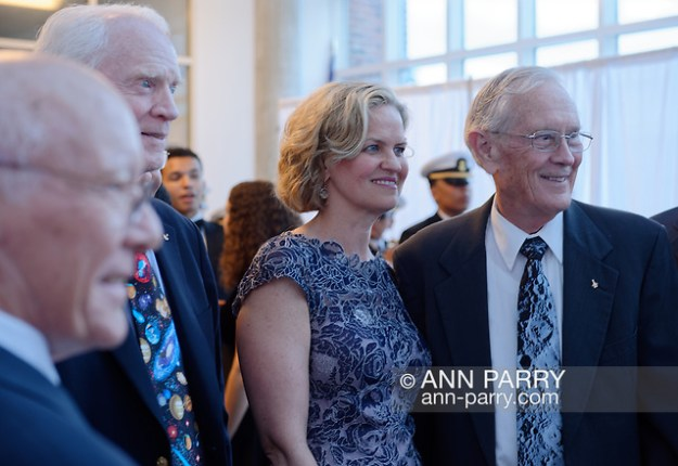 Garden City, New York, U.S. June 6, 2019. L-R, GERRY GRIFFIN, Apollo Flight Director; Apollo 9 astronaut RUSTY SCHWEICKART; Nassau County Executive LAURA CURRAN; and Apollo 16 astronaut CHARLIE DUKE pose for photo at Cradle of Aviation Museum during Apollo at 50 Anniversary Dinner, an Apollo astronaut tribute celebrating the Apollo 11 mission Moon landing. (Ann Parry/Ann Parry, ann-parry.com)