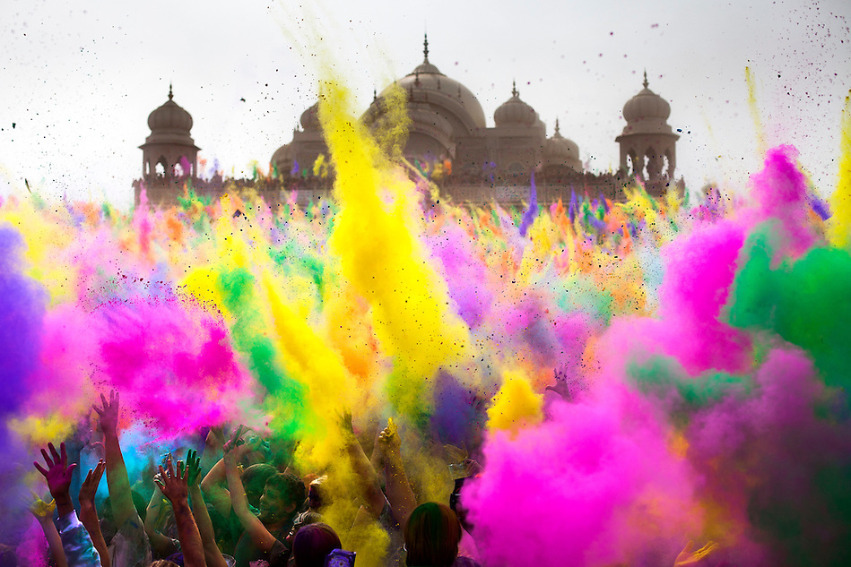 Thousands throw colored powder in sequence every 2 hours during the Holi Festival of Colors, on Saturday, Mar. 24, 2012, at the Lotus Temple, in Spanish Fork, Utah. (Photo by Benjamin B. Morris ©2012) (Benjamin B. Morris)