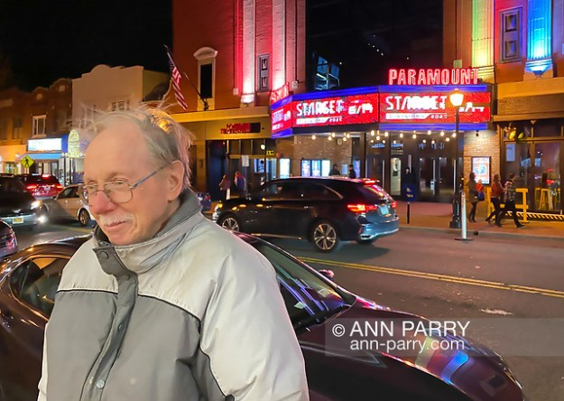 Huntington, New York, U.S. February 29, 2020. BOB STUHMER waits across the street from the Paramount Theater while his friend captures photos, after they left the nearby fotofoto gallery reception. (© 2020 Ann Parry/Ann-Parry.com)