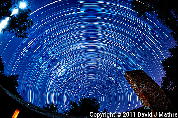 Early morning star trails looking north. Autumn night sky in New Jersey. Composite of 158 images taken with a Nikon D3 camera and 16 mm f/2.8 fisheye lens (ISO 400, 16 mm, f/4, 59 sec). (David J Mathre)