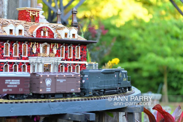 Old Westbury, New York, U.S. June 23, 2021. Old Westbury Gardens has an opening reception for its Great Pine Railway outdoor model train exhibit. The red Westbury House of OWG is one of several Long Island landmarks Leslie Salka Inc created for the unique large G gauge model railroad exhibit, which runs until September 6. (© 2021 Ann Parry/AnnParry.com)